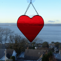 Large bright red stain glass heart
