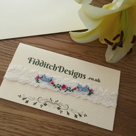 Dainty Bridal garter, with bluebirds and flowers.