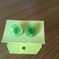 button stud earrings green on green
