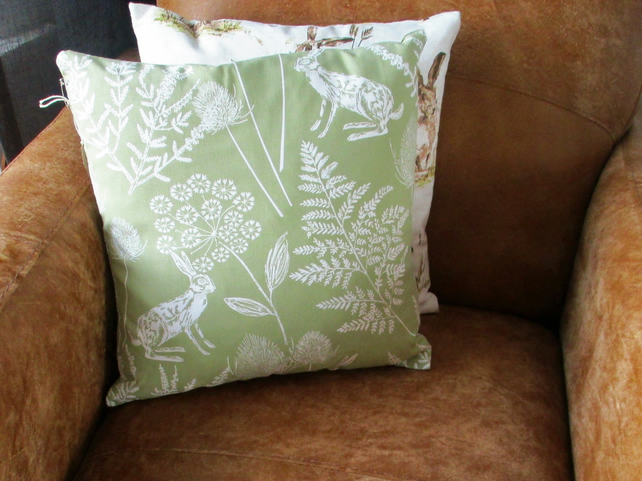 Green cotton hand sewn Hare cushion with feather pad