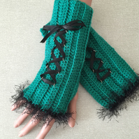 Hand crocheted wrist warmers in green with black ribbon