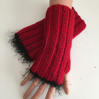 Hand crocheted wrist warmers in red with black edging