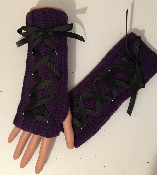Hand crocheted wrist warmers in purple