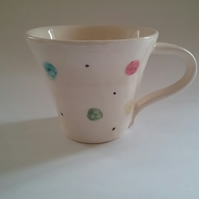 Hand thrown ceramic pottery spotty mug or cup