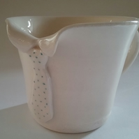 Individual hand-thrown ceramic pottery mug or cup with tie detail.