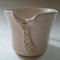 Hand-thrown ceramic pottery collar mug or cup with green and yellow striped tie.