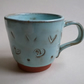 Terracotta hand-thrown expresso mug or cup with pale aqua blue glaze