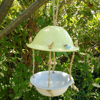 Hand made ceramic yellow and grey bird feeder with hand crafted and painted bird