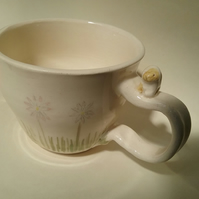 Hand thrown bunny rabbit and daisy mug or cup