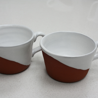 Pair of half-glazed terracotta coffee cups