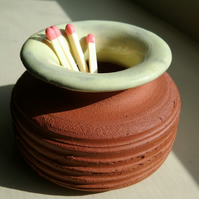 Handmade handthrown ceramic terracotta glazed match striker pot.