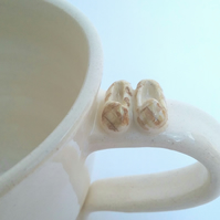 Hand thrown ceramic mug with tiny dad's slippers! A good cup for a gift..