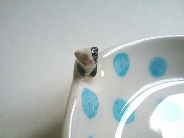 Hand made small spotty ceramic cat bowl with tiny cat and fish