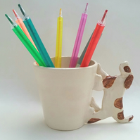 Handthrown ceramic dog pen pot or handmade cup for craft storage