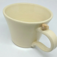 Handmade cream ceramic mug with puppy on the handle . Dog lover pottery gift cup