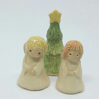 Handmade ceramic angels and Christmas tree cake toppers for baking & decorating