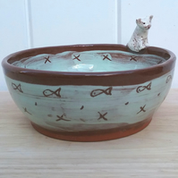 Hand made ceramic cat bowl in turqoise on terracotta clay with white cat figure