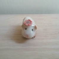 Handmade guinea pig figure in white clay with red poppy for pocket pet lover