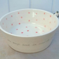 Handmade ceramic dog bowl with red dots and little dog figure & pawprints