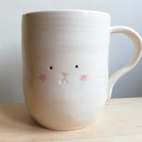 Handmade bunny rabbit mug in white clay - handpainted face & cotton tail cup