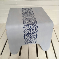 Curved coffee tables with stencil design