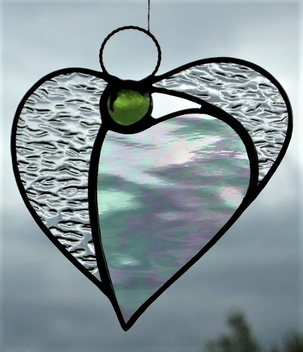 Stained glass (Angel Heart) in textured and iridescent textured clear glass