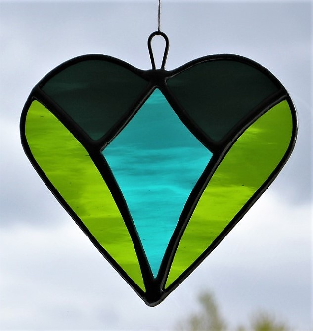 Stained glass suncatche love heart in teal green, moss green and dark teal green