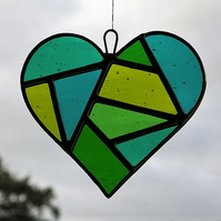 Stained Glass suncatcher Love Heart in a mixture of greens and textured glass