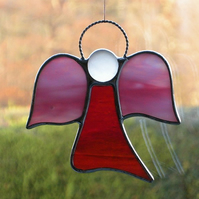 Stained glass (Angel) abstract in red and pink opalecent iridescent glass