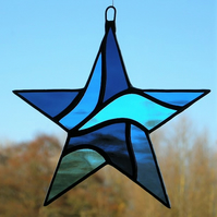 Stained Glass Star (Abstract) in three different blues rippling water glass