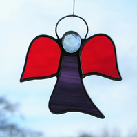 Stained glass (Angel) abstract in red and two purples waterglass
