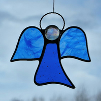 Stained glass (Angel) abstract in blue and blue streaky textured glass