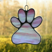 Paw Print suncatcher in pink and white translucent iridescent glass