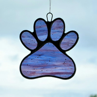 Paw Print suncatcher in blue and purple streaky glass