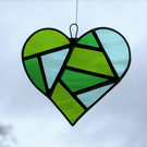 Stained glass suncatcher love heart in medium green,moss green and pale green