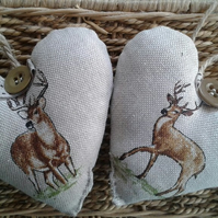 Pair of Highland stag print fabric heart decorations