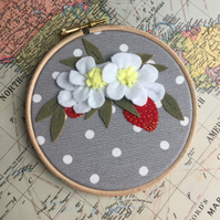strawberry blossm wall hanging in embroidery hoop