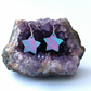 Fun marbled paper star earrings with iridescent purple sterling silver findings