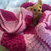 chunky hand knitted dusky pink and cerise pink pet blanket