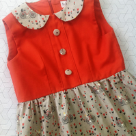 Dress with orange and beige bicycles print with collar age 7-8