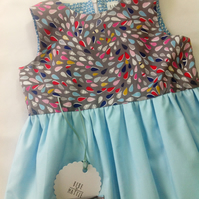 Dress with rainbow teardrop design bodice with light blue skirt age 4-5