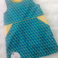 Blue and yellow floral a-line dress with decorative pockets age 4-5