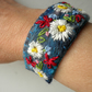 felted and embroidered summer cuff with daisies and toggle clasp