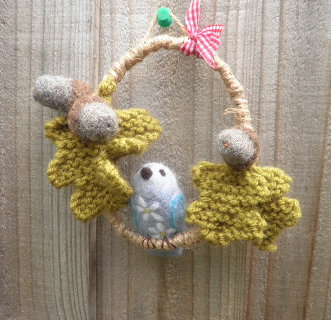 felted blue daisy bird among oak leaves and acorns hanging felted decoration
