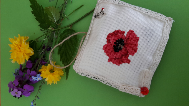 Handmade poppy crosstitch ornament