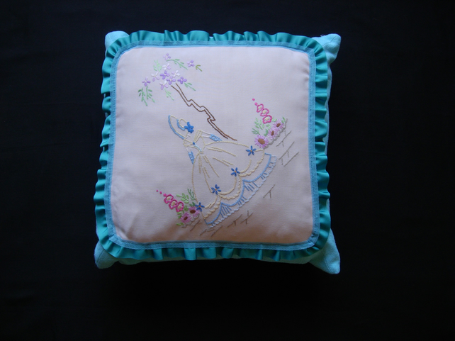Vintage embroidered fabric frilled cushion mainly turquoise-blue