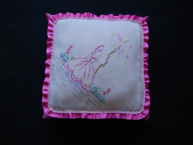 Vintage embroidered fabric frilled cushion mainly pink