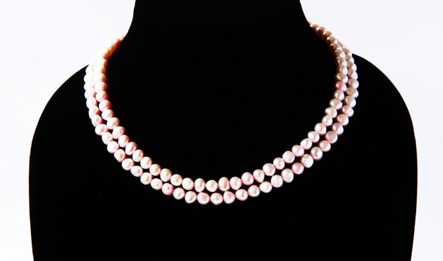 Pale pink freshwater pearl necklace; double strand silver-plated