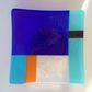 Colourful blue and yellow fused glass bowl