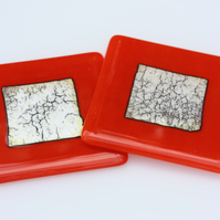 An orange and silver coaster set, pair of handmade fused glass drink coasters